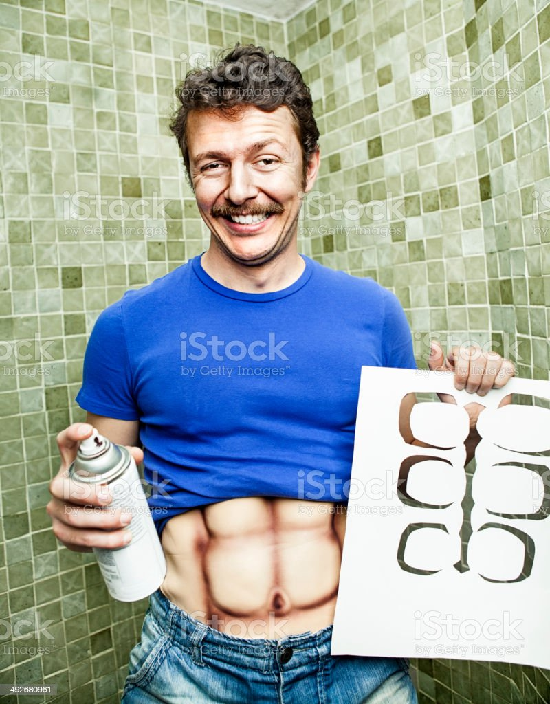 Fake muscles stock photo