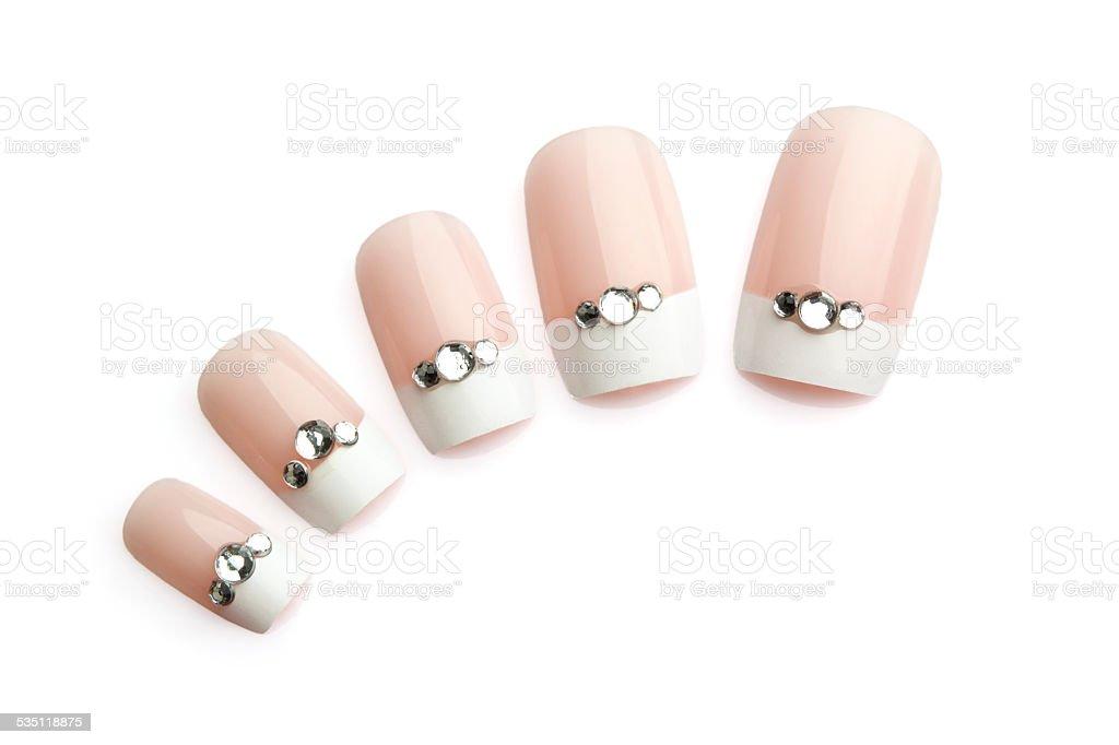 Fake nails with diamond bits stock photo