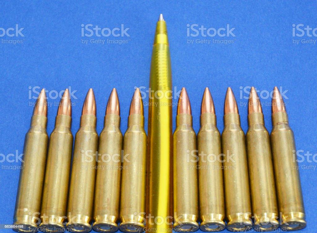 Fake News Invasion Concept.  Pen with Military Ammo - Propaganda in Mass Media. stock photo