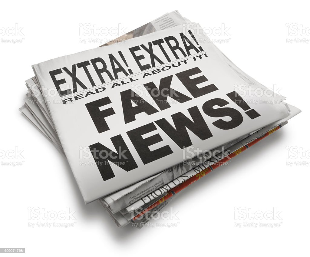 'Fake News' Newspaper Headline On White Background stock photo