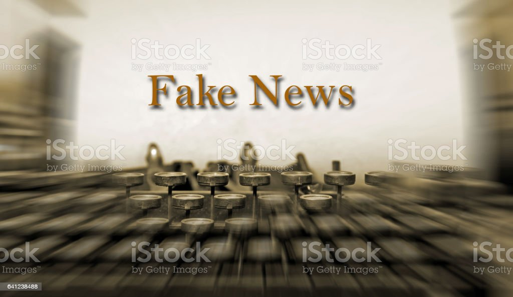 Fake News on Antique typewriter- defocused stock photo