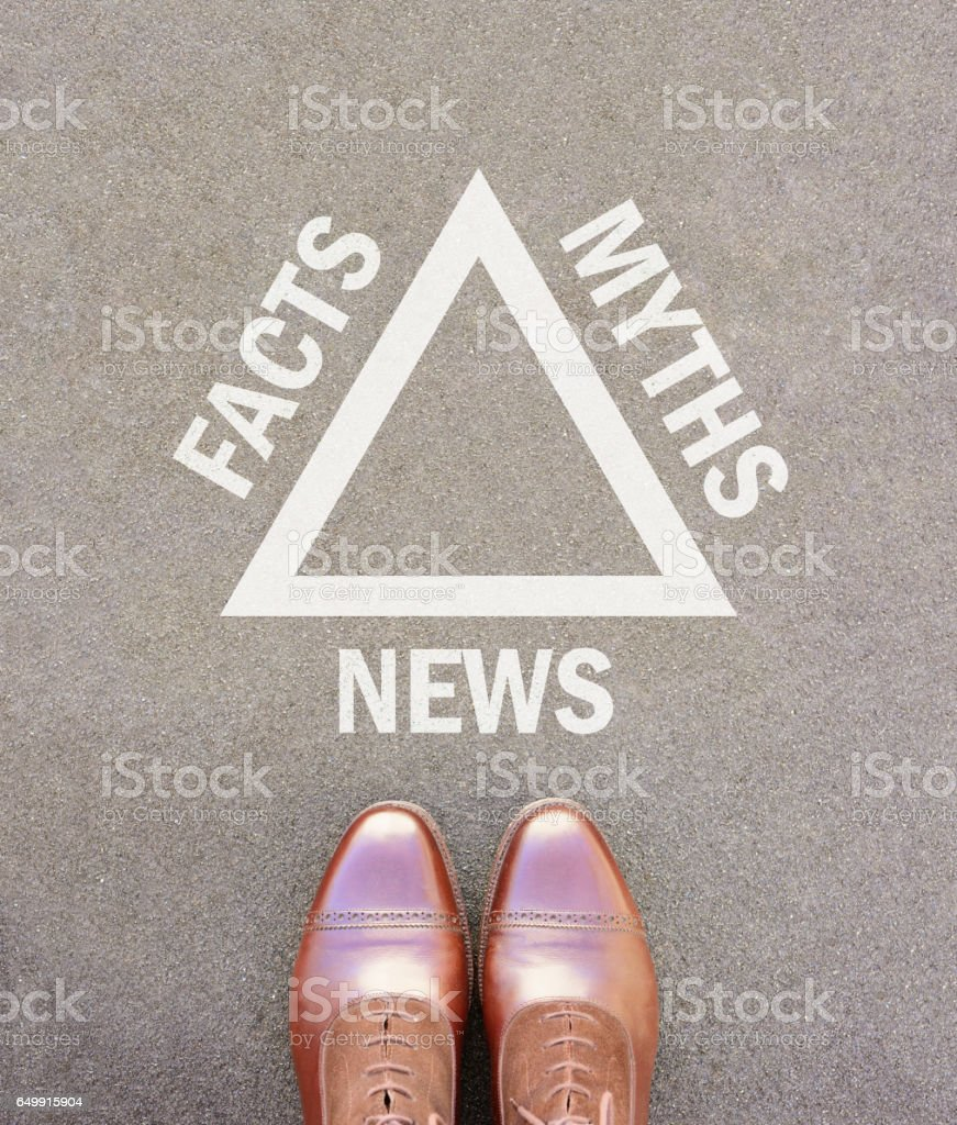 Fake news triangle and business shoes stock photo