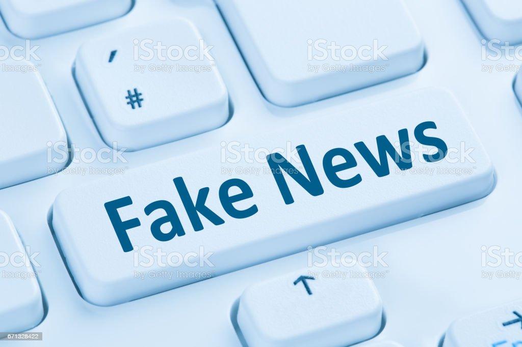 Fake news truth lie media internet button online blue computer stock photo