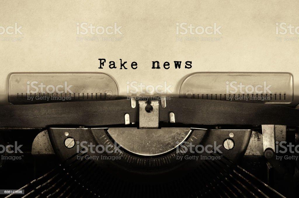 Fake news words typed on vintage typewriter. stock photo