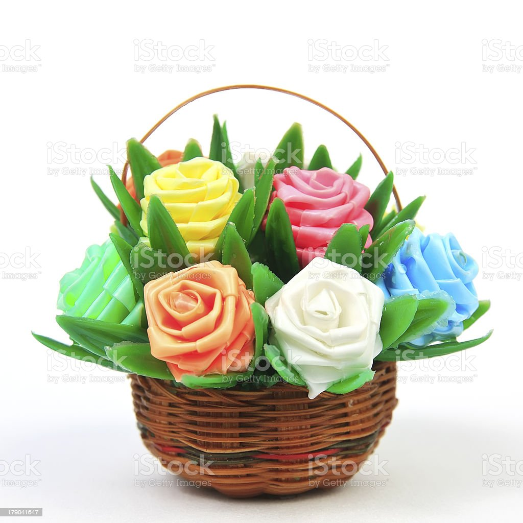 fake rose flower varicolored in rattan basket stock photo