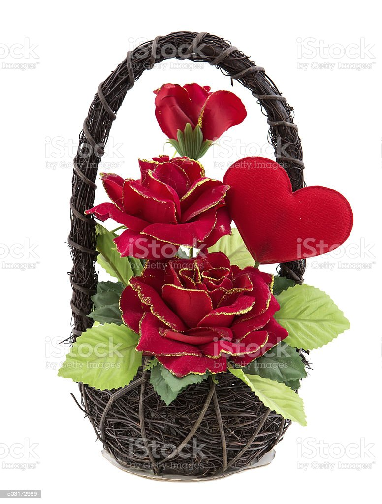 fake rose flower with heart in rattan basket on white stock photo