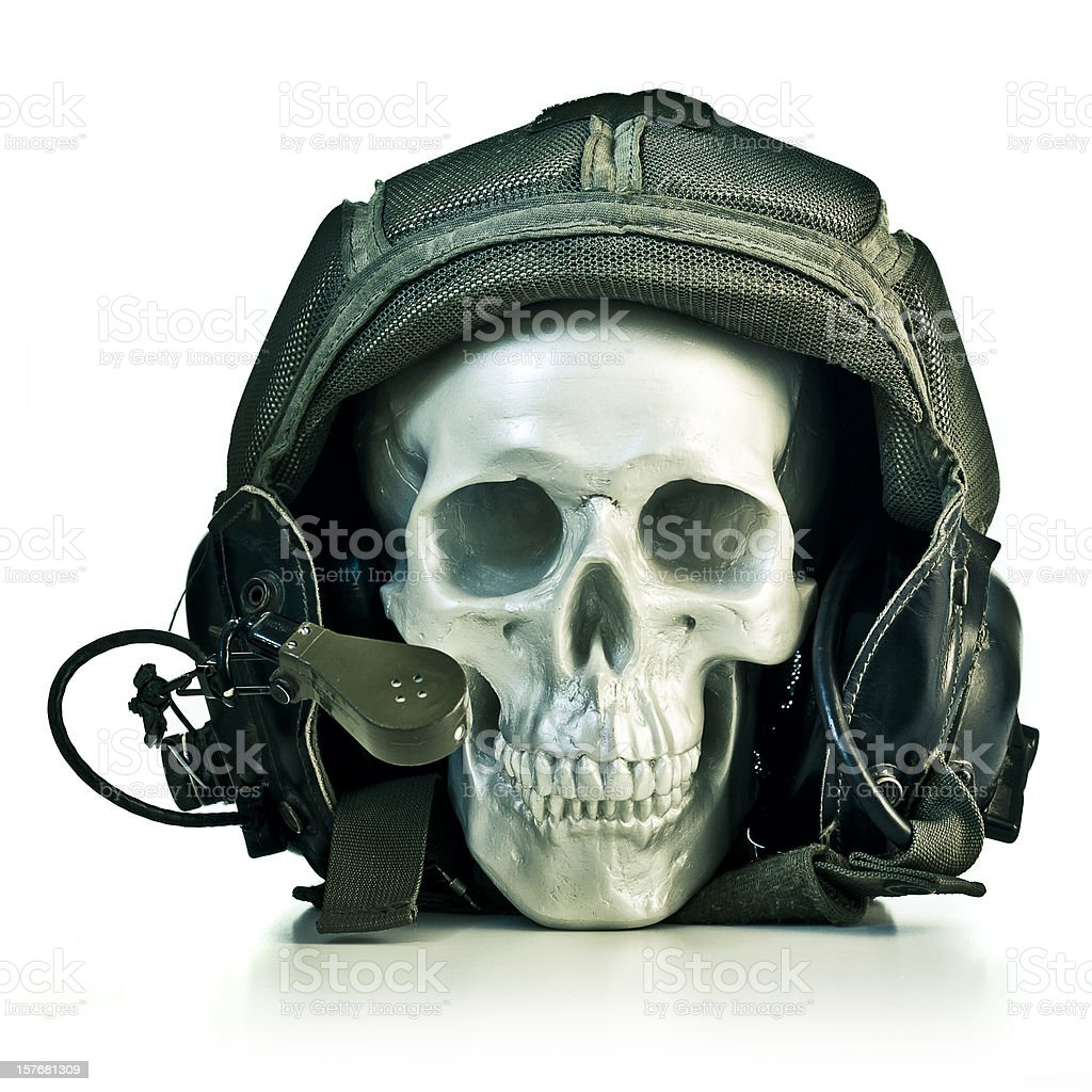 fake skull wearing a military pilot helmet royalty-free stock photo