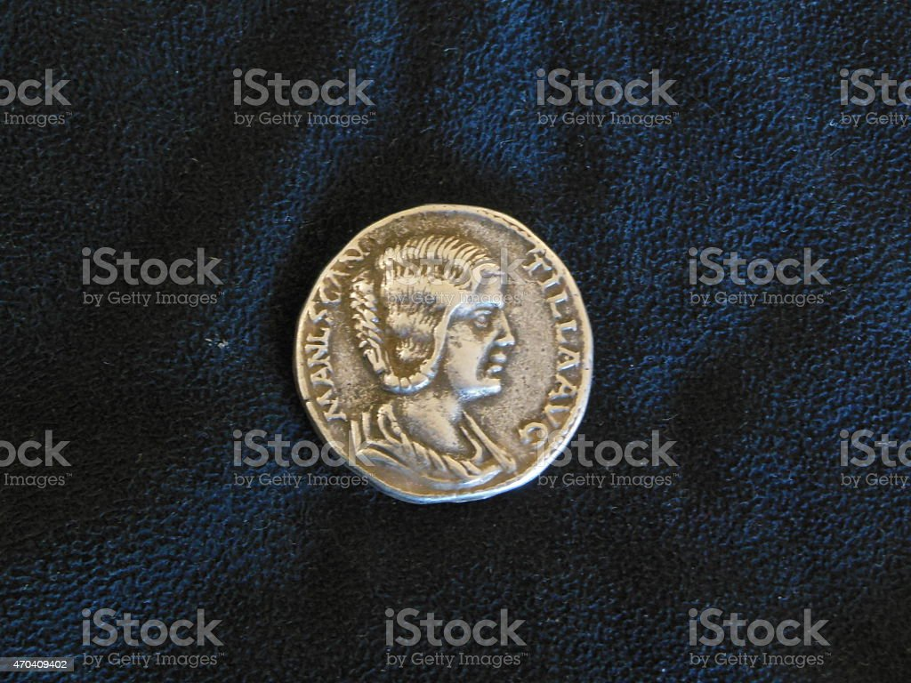 Faked copy of ancient coin on black velvet stock photo