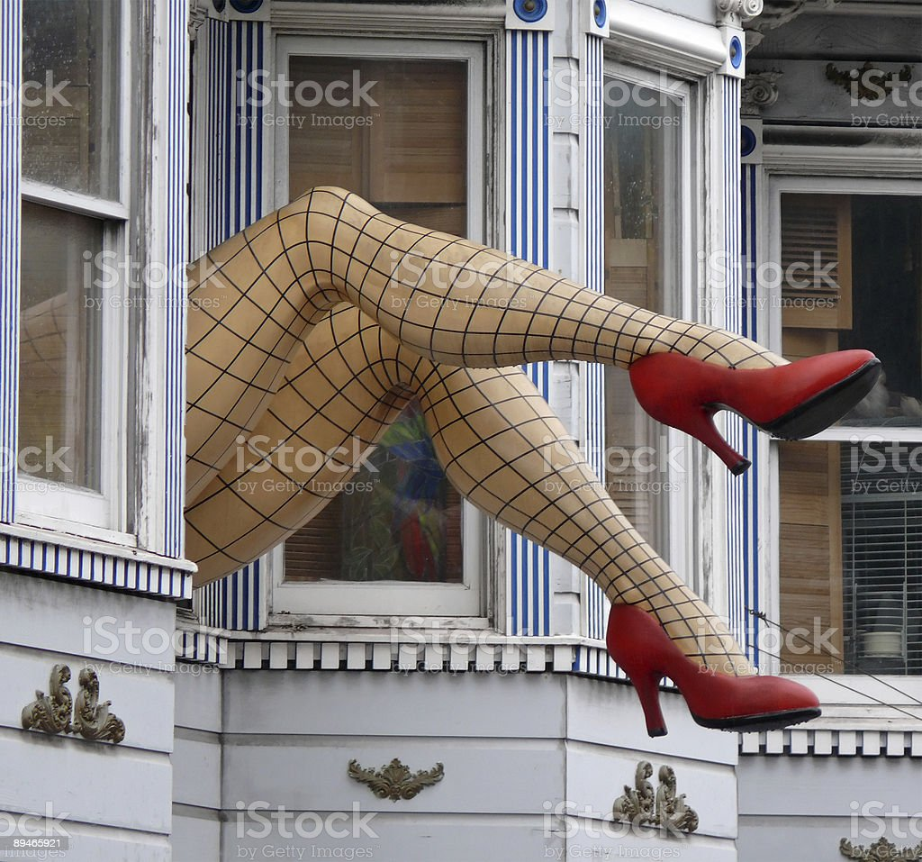 faked female legs with stockings and red shoes royalty-free stock photo