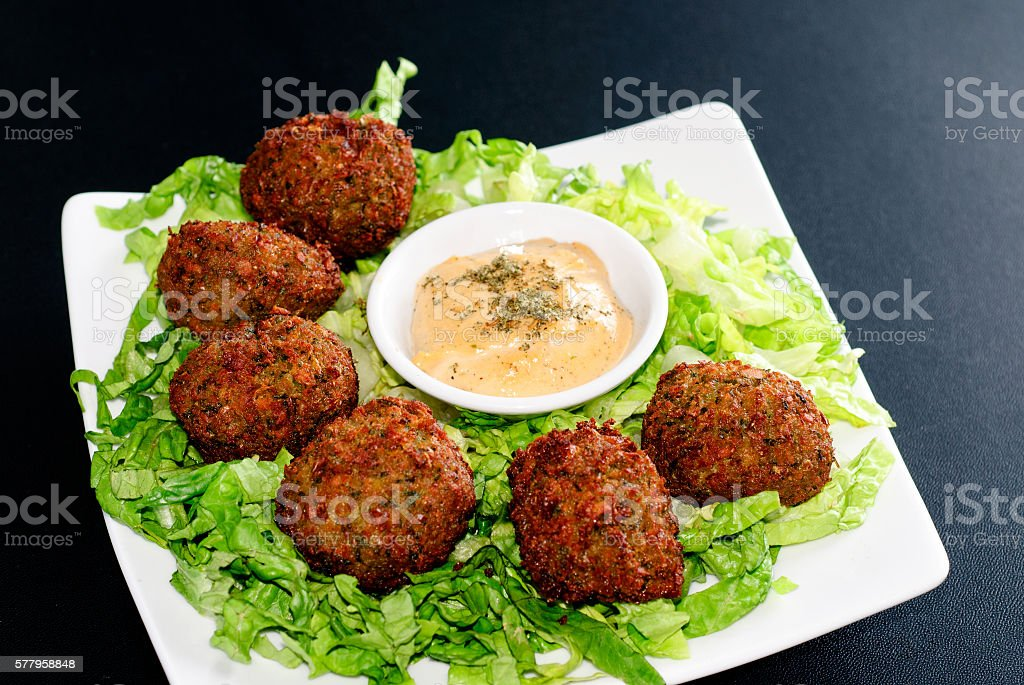 falafel with hummus dip stock photo