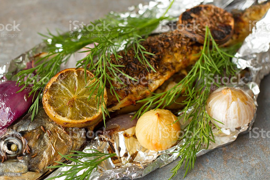 falgu fish with lime garlic and onion stock photo