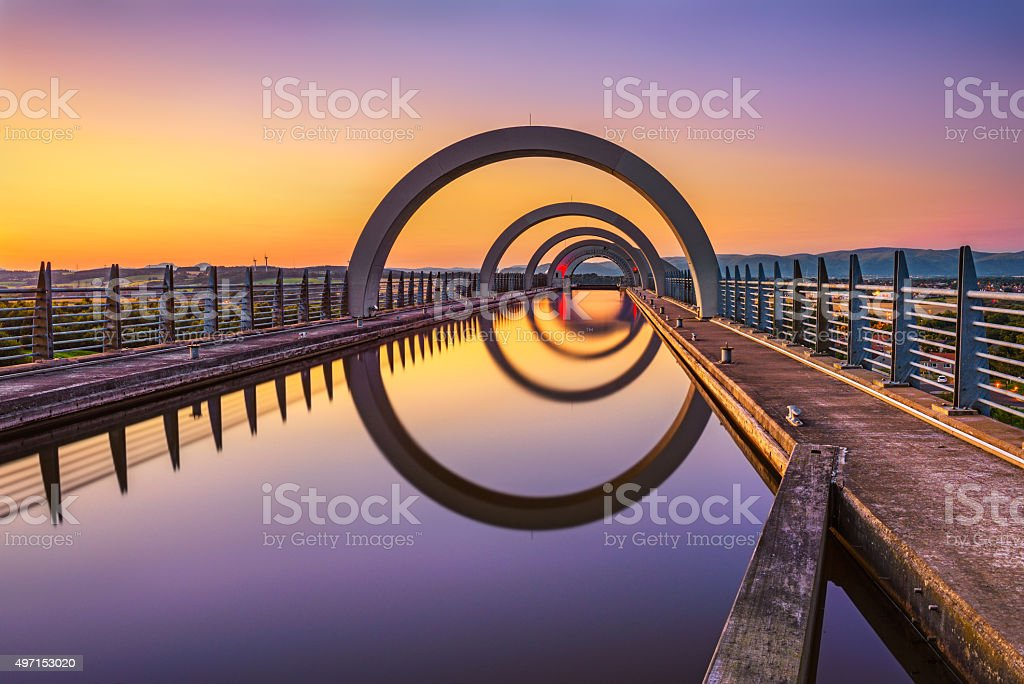 Falkirk Wheel at sunset. Falkirk Wheel is a rotating boat lift in...