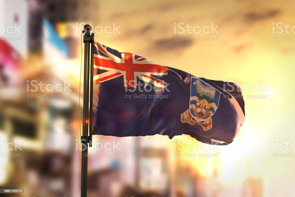 Falkland Islands Flag Against City Blurred Background At Sunrise Backlight stock photo
