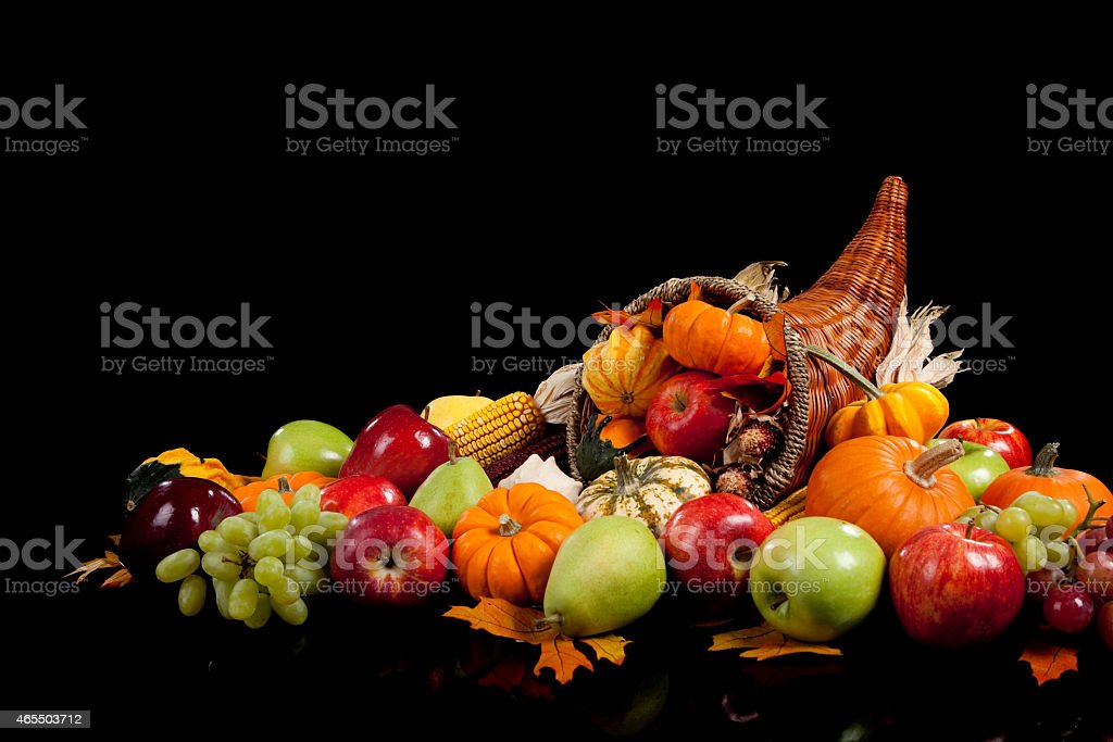 Fall arrangement of fruits and vegetables in a cornucopia stock photo