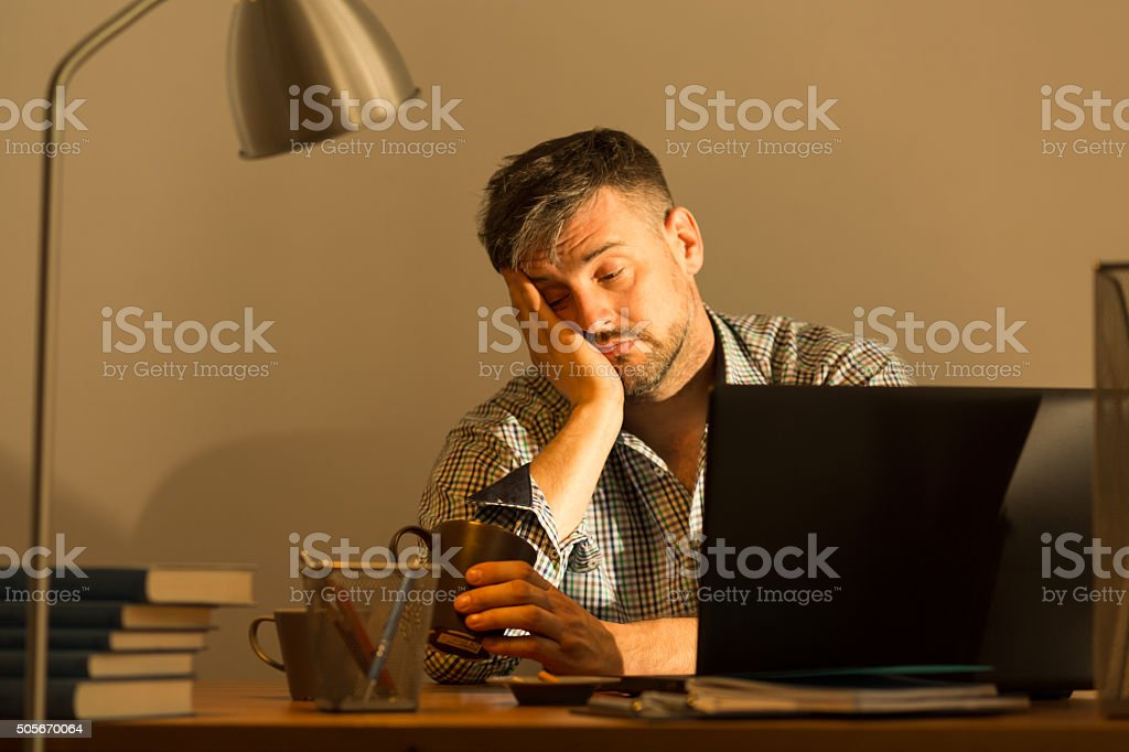 Fall asleep while working stock photo
