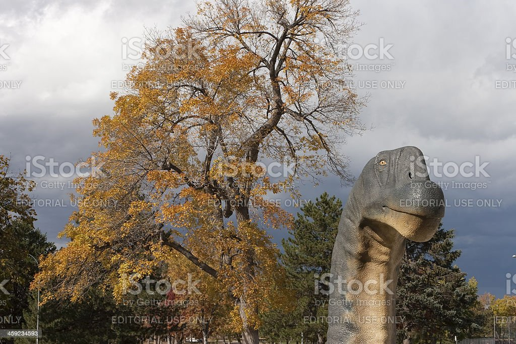 Fall colors and Camarasaurus dinosaur sculpture Denver Museum Colorado royalty-free stock photo