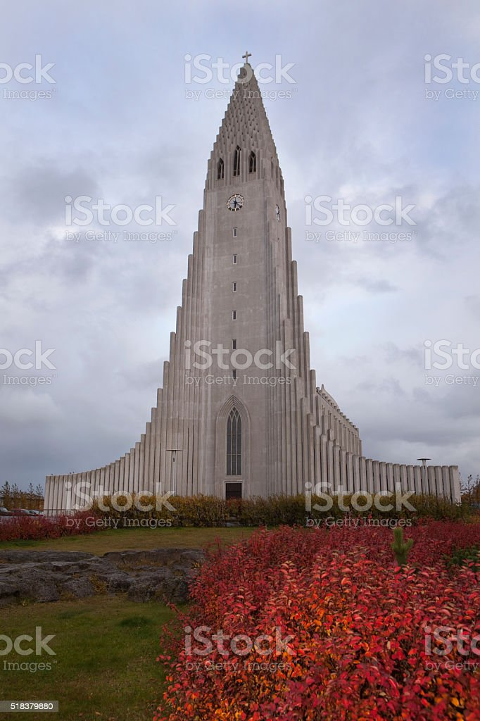 Fall colors surround Hallgrímskirkja Lutheran Church in Iceland stock photo