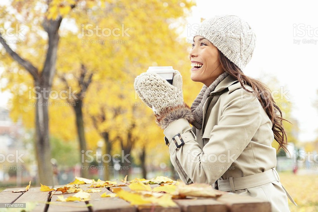 Fall concept - autumn woman drinking coffee royalty-free stock photo