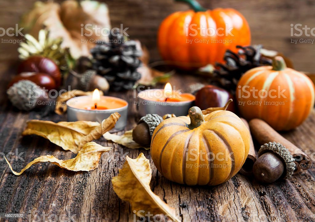 Fall Decoration.Pumpkins,Orange Candles,Cinnamon,Chestnuts and stock photo