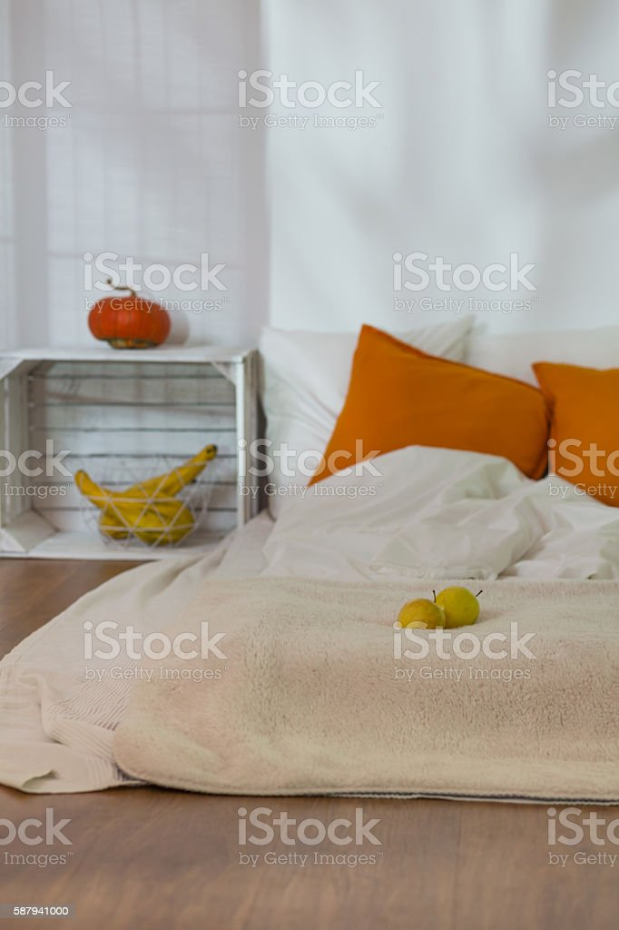 Fall decorations in cozy simple bedroom stock photo