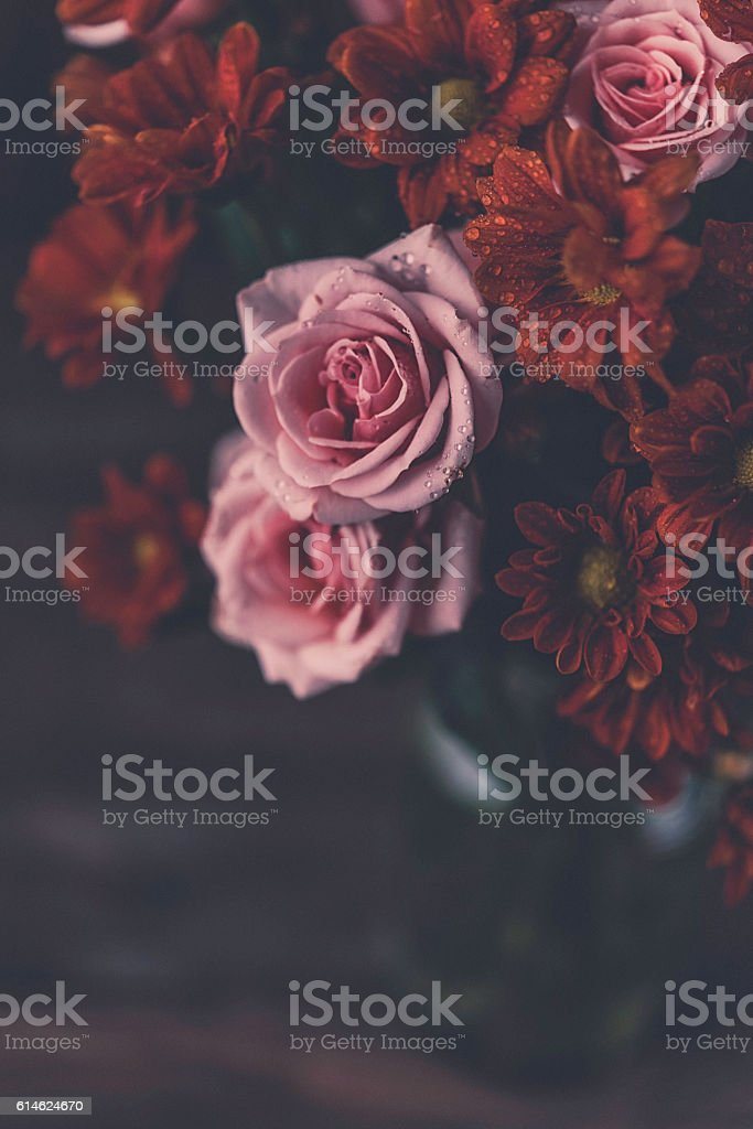 Fall flower arrangement with pink roses and chrysanthemums stock photo