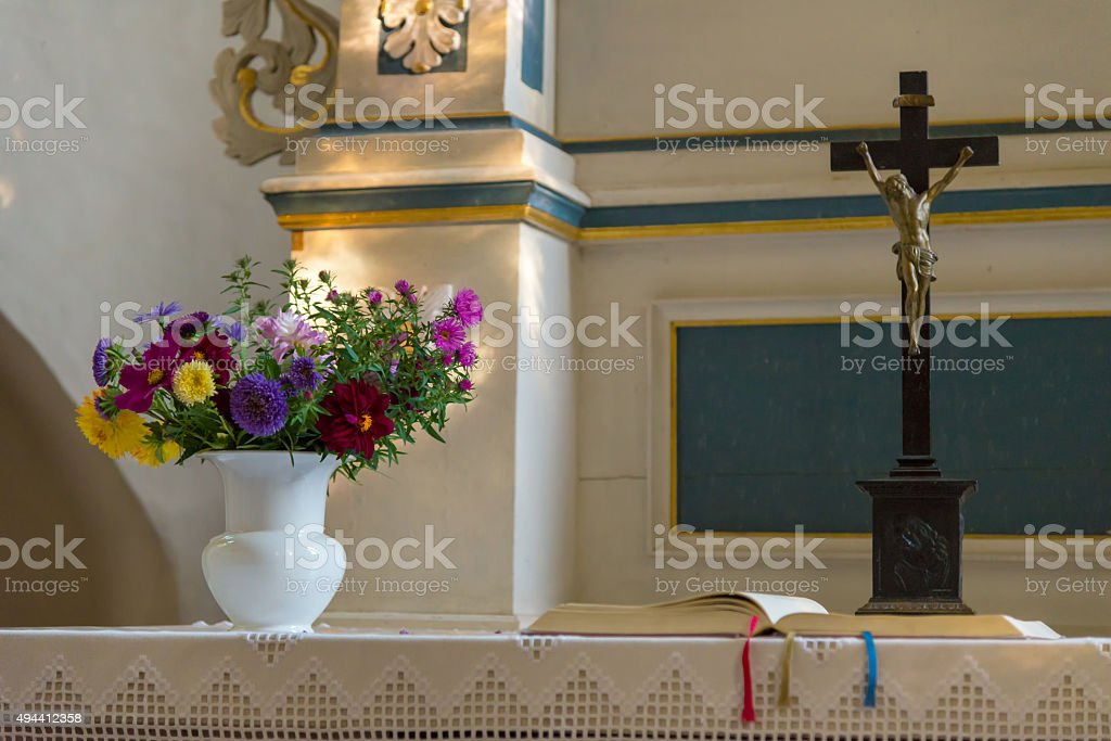 fall flowers, cross and bible at an altar stock photo