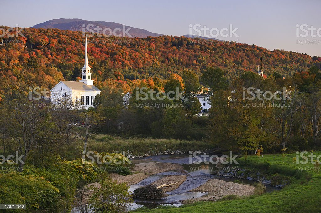 Fall foliage behind a rural Vermont church stock photo