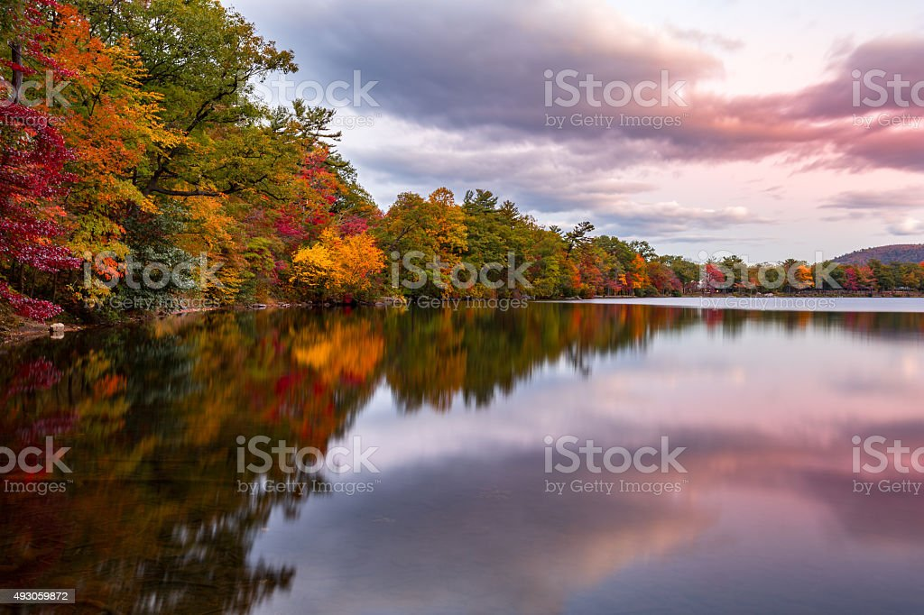 Fall foliage reflects in Hessian Lake stock photo
