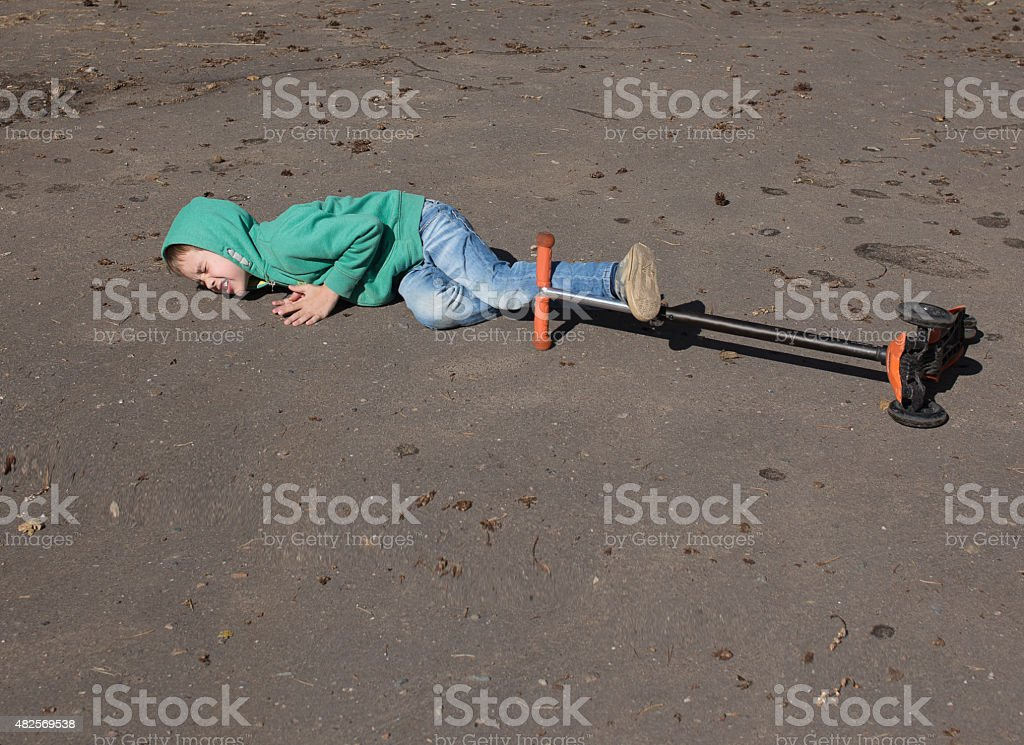 fall from scooter stock photo