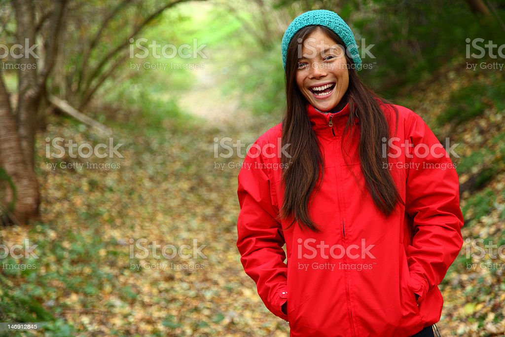 Fall girl laughing in forest royalty-free stock photo