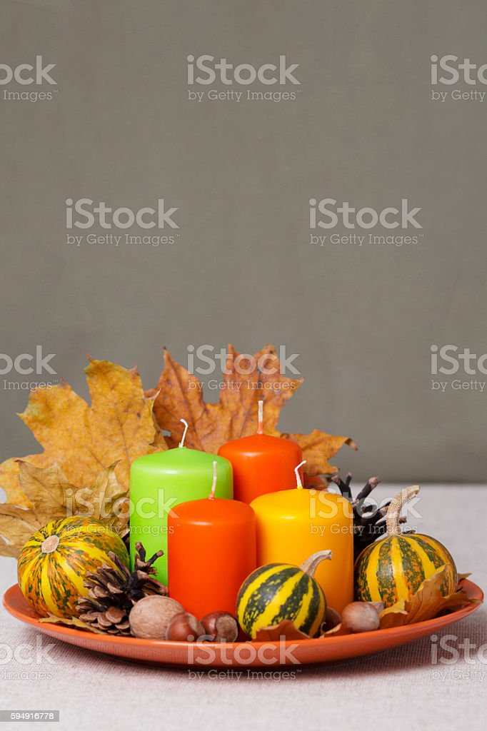 Fall holidays - Halloween and Thanksgiving. Still life - candles and...