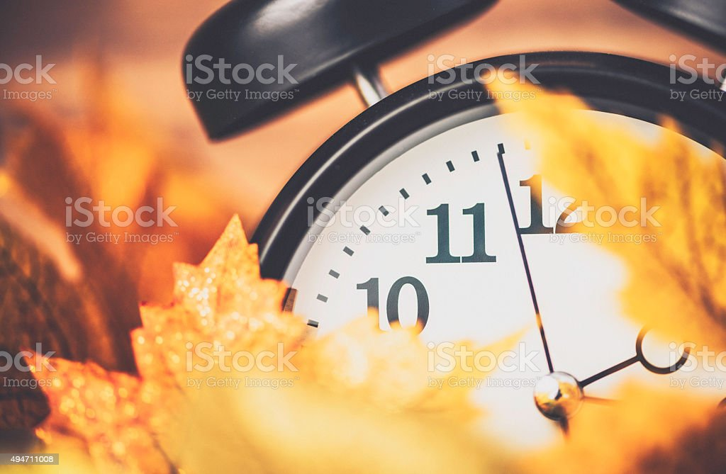 Fall is time to turn back time. Daylight Savings Time stock photo