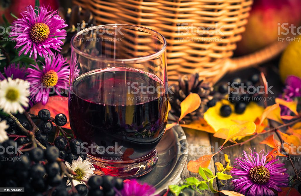 Fall kitchen cup tincture chokeberry wooden table stock photo