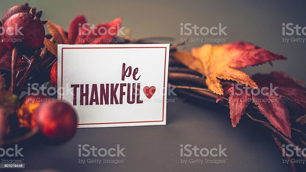 Fall leaves background with wreath and message for Thanksgiving stock photo
