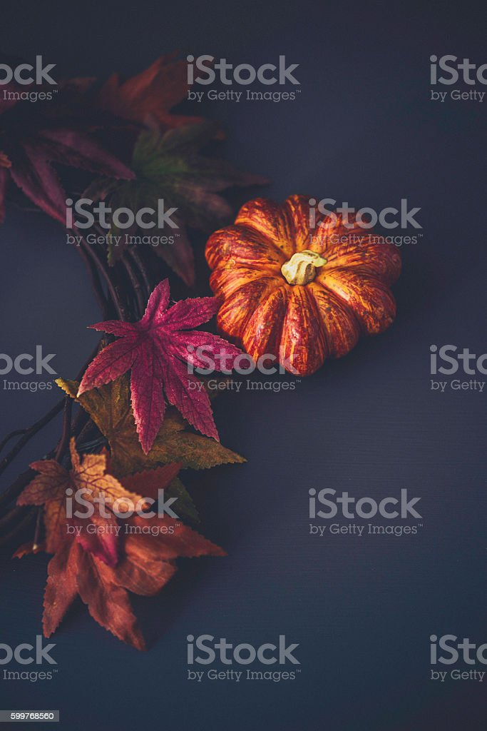 Fall leaves background with wreath and pumpkin for Thanksgiving stock photo