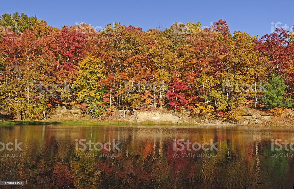 Fall Reflections on a Quiet Lake stock photo