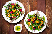 Fall salad with greens, arugula, walnuts, beetroot and roasted squash