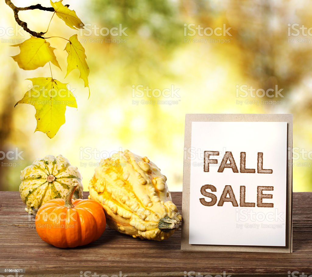 Fall Sale sign over yellow autumn leaves background stock photo