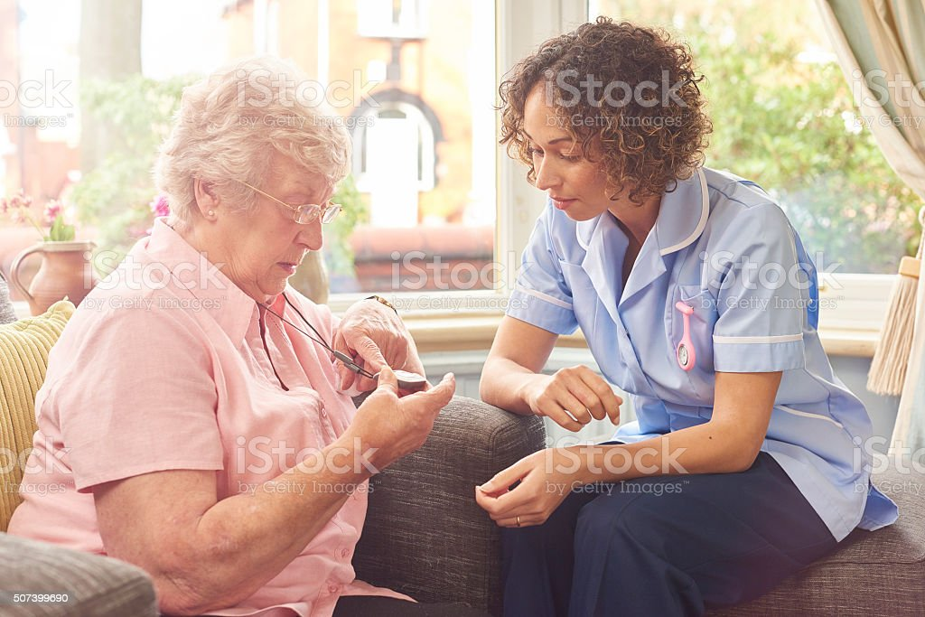 fall sensor pendant for senior woman stock photo