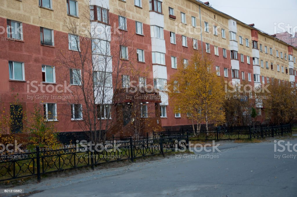 Fall street with red building and yellow autumn trees stock photo
