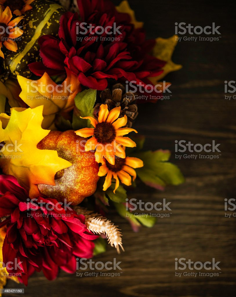 Fall themed decorations forming border on wooden background. Thanksgiving celebrations. stock photo
