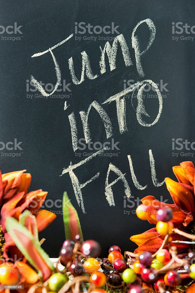 Fall themed still life with chalkboard stock photo