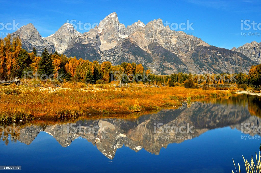 Fall water reflections in The Grand Tetons. stock photo