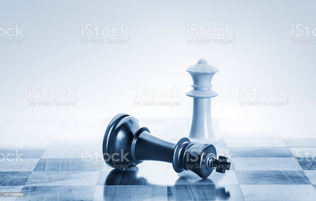 Fallen chess king as a metaphor for fall from power stock photo