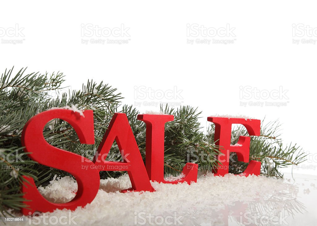 Fallen Christmas tree with sale written in red stock photo