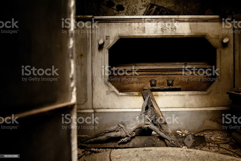 Fallen crucifix in a derelict tomb, La Recoleta Cemetery royalty-free stock photo