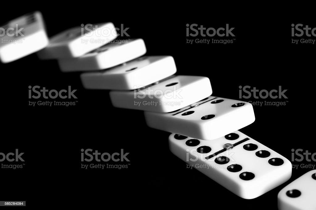 Fallen dominoes: chain reaction, defeat, etc stock photo
