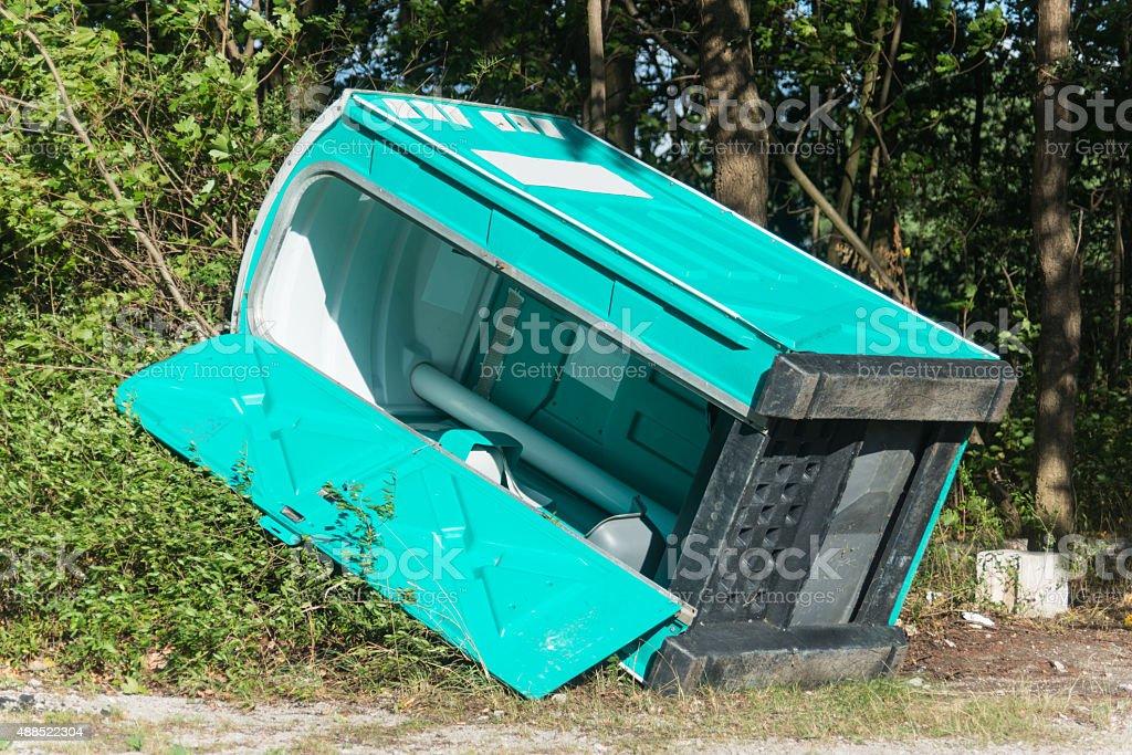 fallen down mobile toilet stock photo