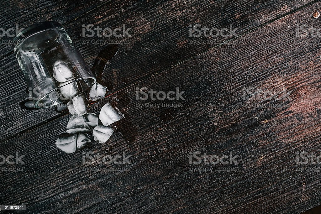 Fallen drinking glass with ice stock photo