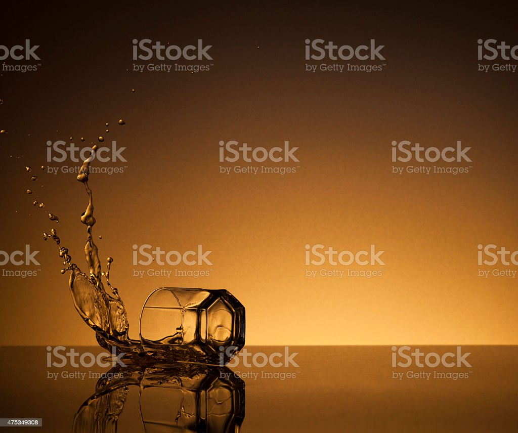 Fallen glass of whiskey stock photo